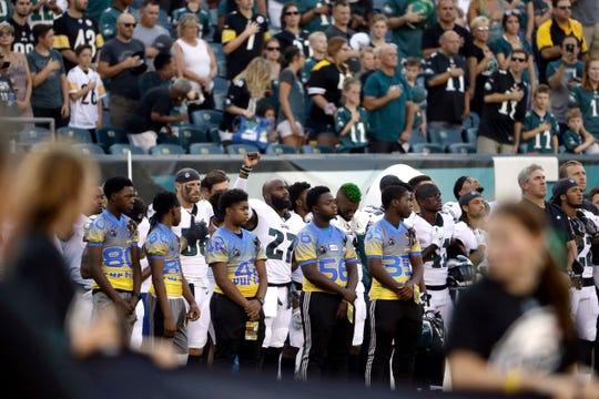 Philadelphia Eagles' Malcolm Jenkins, center left, raises his fist during the national anthem before the team's preseason NFL football game against the Pittsburgh Steelers, Thursday, Aug. 9, 2018, in Philadelphia. (AP Photo/Matt Rourke)