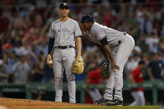 Aug 5, 2018; Boston, MA, USA; New York Yankees relief pitcher Aroldis Chapman (54) reacts after giving up the tying run as first baseman Greg Bird (33) looks on during the ninth inning against the Boston Red Sox at Fenway Park.