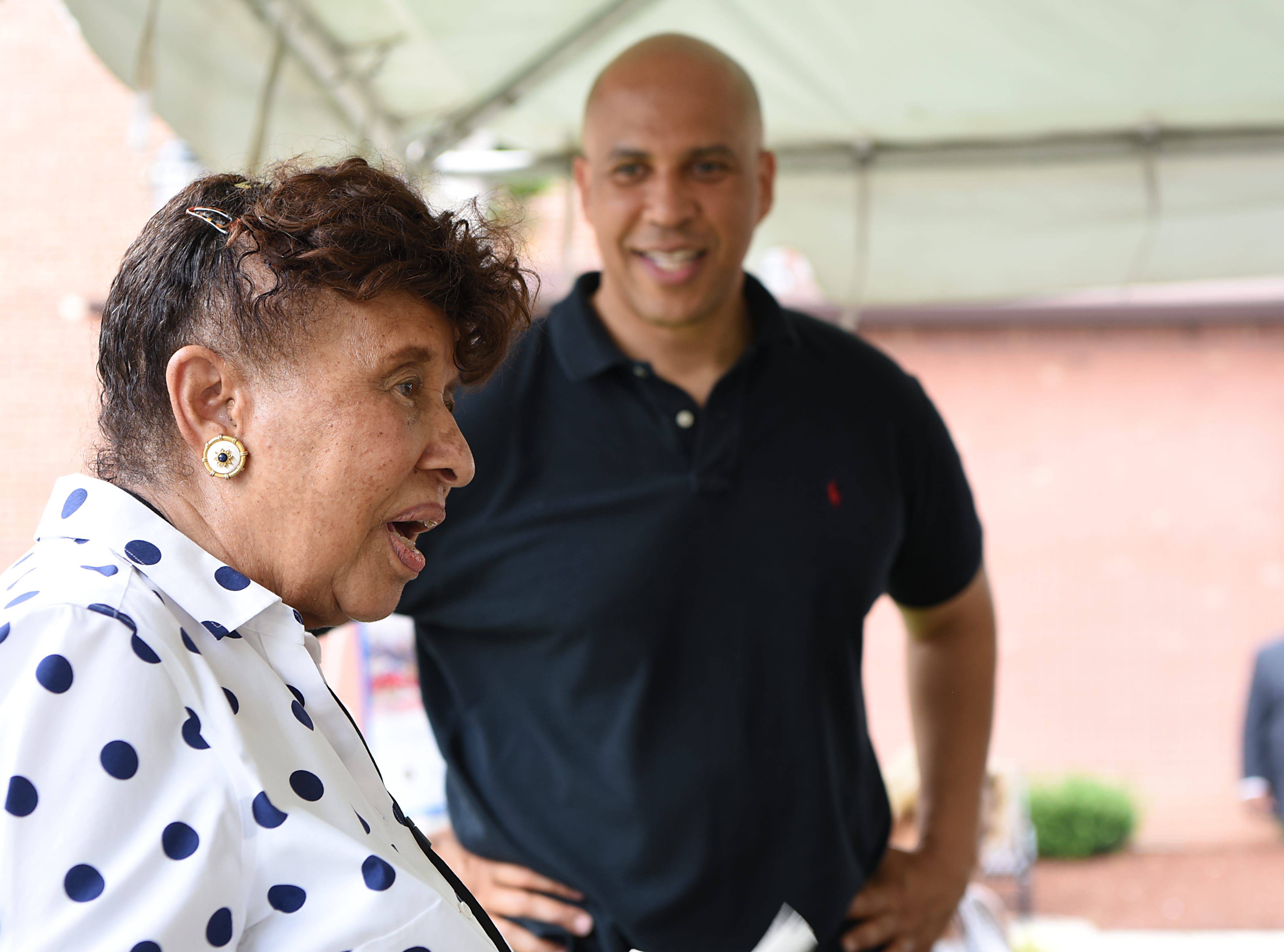 Lee Porter and Cory Booker share some stories during the Fair Housing Council of Northern New Jersey picnic in Hackensack on Friday August 10, 2018.
