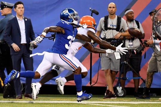 New York Giants defensive back B.W. Webb (37) breaks up a pass intended for Cleveland Browns wide receiver Antonio Callaway (11). The New York Giants face the Cleveland Browns in a preseason game in East Rutherford, NJ on Thursday, August 9, 2018.