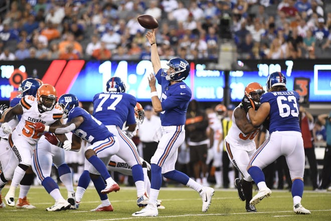 New York Giants quarterback Davis Webb (5) throwing in the second quarter. The New York Giants face the Cleveland Browns in a preseason game in East Rutherford, NJ on Thursday, August 9, 2018.