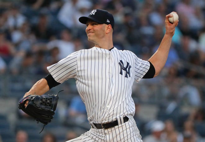 New York Yankees starting pitcher J.A. Happ delivers against the Texas Rangers during the second inning of a baseball game, Thursday, Aug. 9, 2018, in New York.