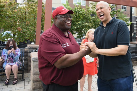 Deputy Mayor of Hackensack Dave Sims greets Senator Cory Booker during the Fair Housing Council of Northern New Jersey picnic in Hackensack on Friday August 10, 2018.