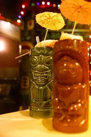 Drinks are served at Lee's Hawaiian Islander in Clifotn December 20, 2001.