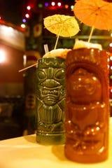 Drinks are served at Lee's Hawaiian Islander in Clifotn December 20, 2001.