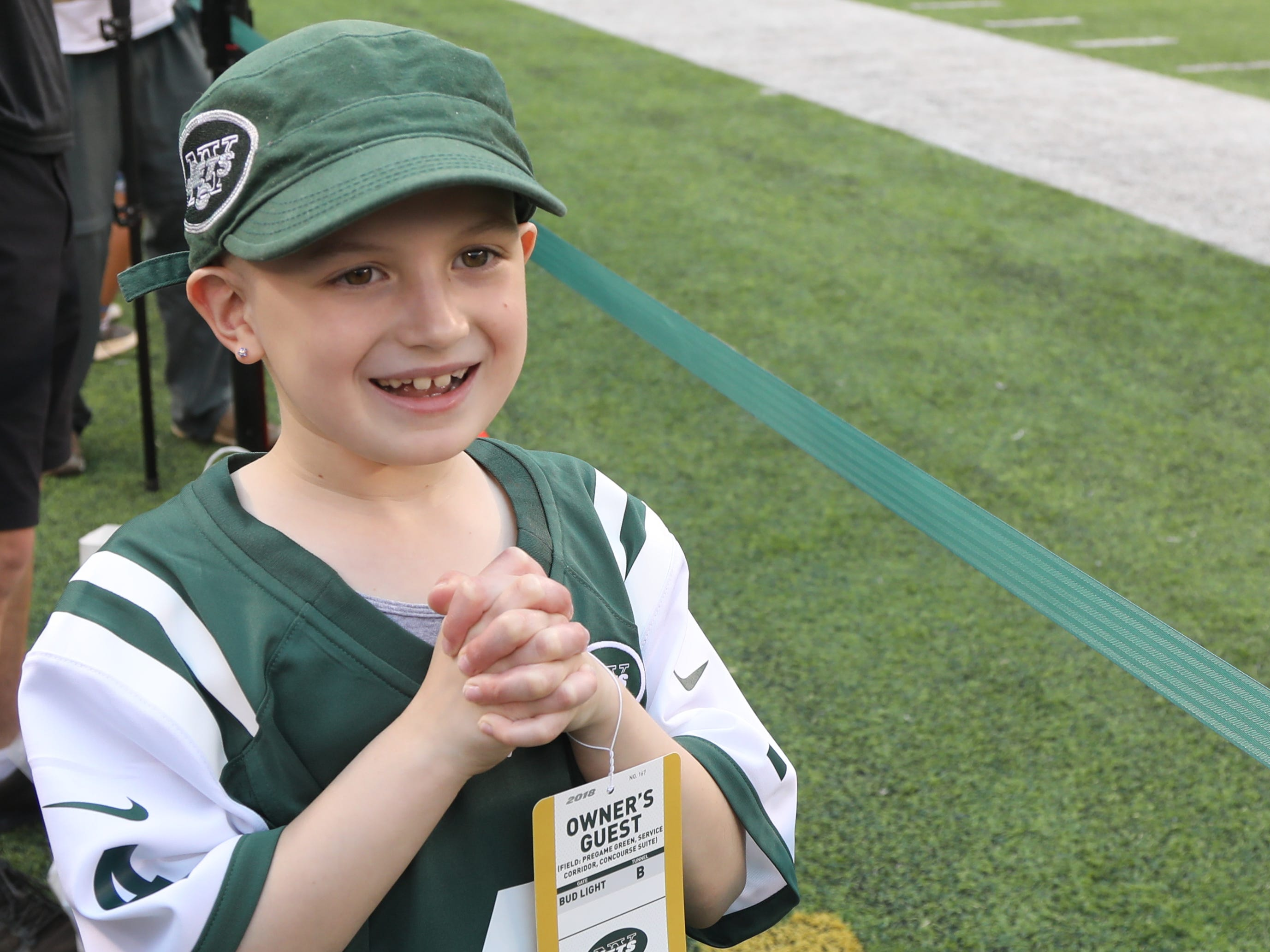 The Jets honorary captain for Friday night's preseason game against the Atlanta Falcons, Grace Eline, 9, of the Gillette section of Long Hill Twp., NJ, watches her team take to the MetLife field for pregame warmups, Aug. 10, 2018.