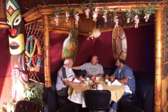 Ridgefield Park NJ September 6 2001 The interior of Chan's Dragon Inn, Polynesian restuarant. Bob Gottschalk of Little Ferry, Timothy Rock of Ft. Lee and Al Rosenshein share a drink at a table in a corner of the restuarant.