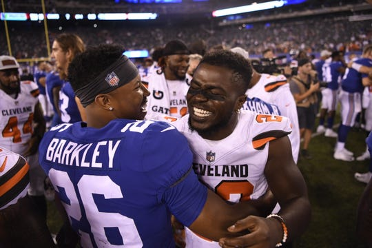 New York Giants running back Saquon Barkley (26) and Cleveland Browns defensive back Jabrill Peppers (22) hug after the game. The Cleveland Browns defeated the New York Giants 20-10 in East Rutherford, NJ on Thursday, August 9, 2018.