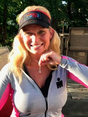 Mary Ellen Loranger was selected to compete in the ultimate triathlon — Ironman Kona in October.