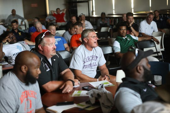 A Ridgewood coach asks a question about the enforcement of new rules at the Super Football Conference Media Day at Wayne Valley High School. Thursday, Aug. 9, 2018