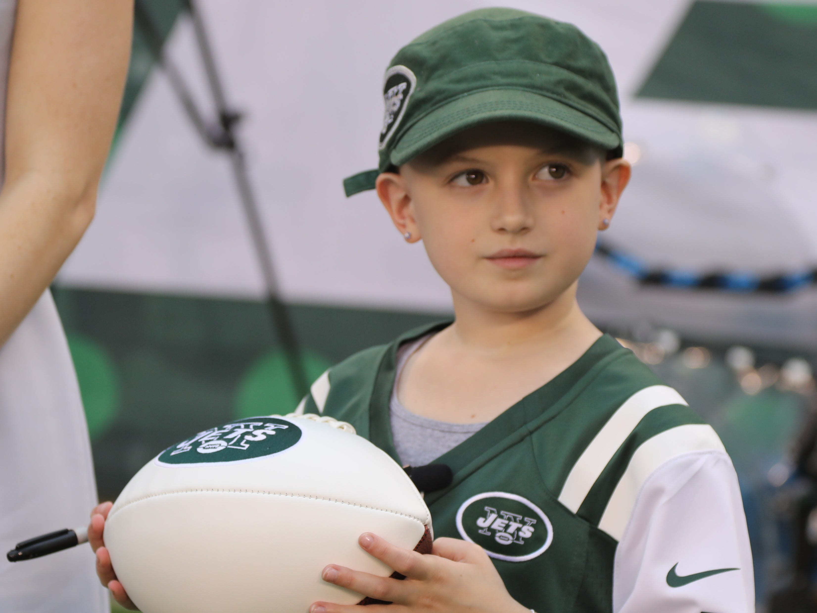The Jets honorary captain for tonight's game, Grace Eline, 9, of the Gillette section of Long Hill Twp., NJ on the MetLife Stadium field during pregame warmups as New York hosted the Atlanta Falcons on Friday, Aug. 10, 2018.