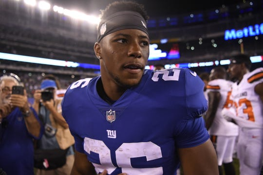 New York Giants running back Saquon Barkley (26) on the field after the game. The Cleveland Browns defeated the New York Giants 20-10 in East Rutherford, NJ on Thursday, August 9, 2018.
