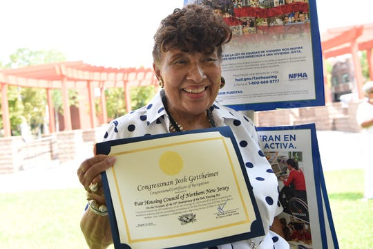 Lee Porter holds a certificate from Congressman Josh Gottheimer. The Fair Housing Council of Northern New Jersey holds a picnic in Hackensack on Friday August 10, 2018.
