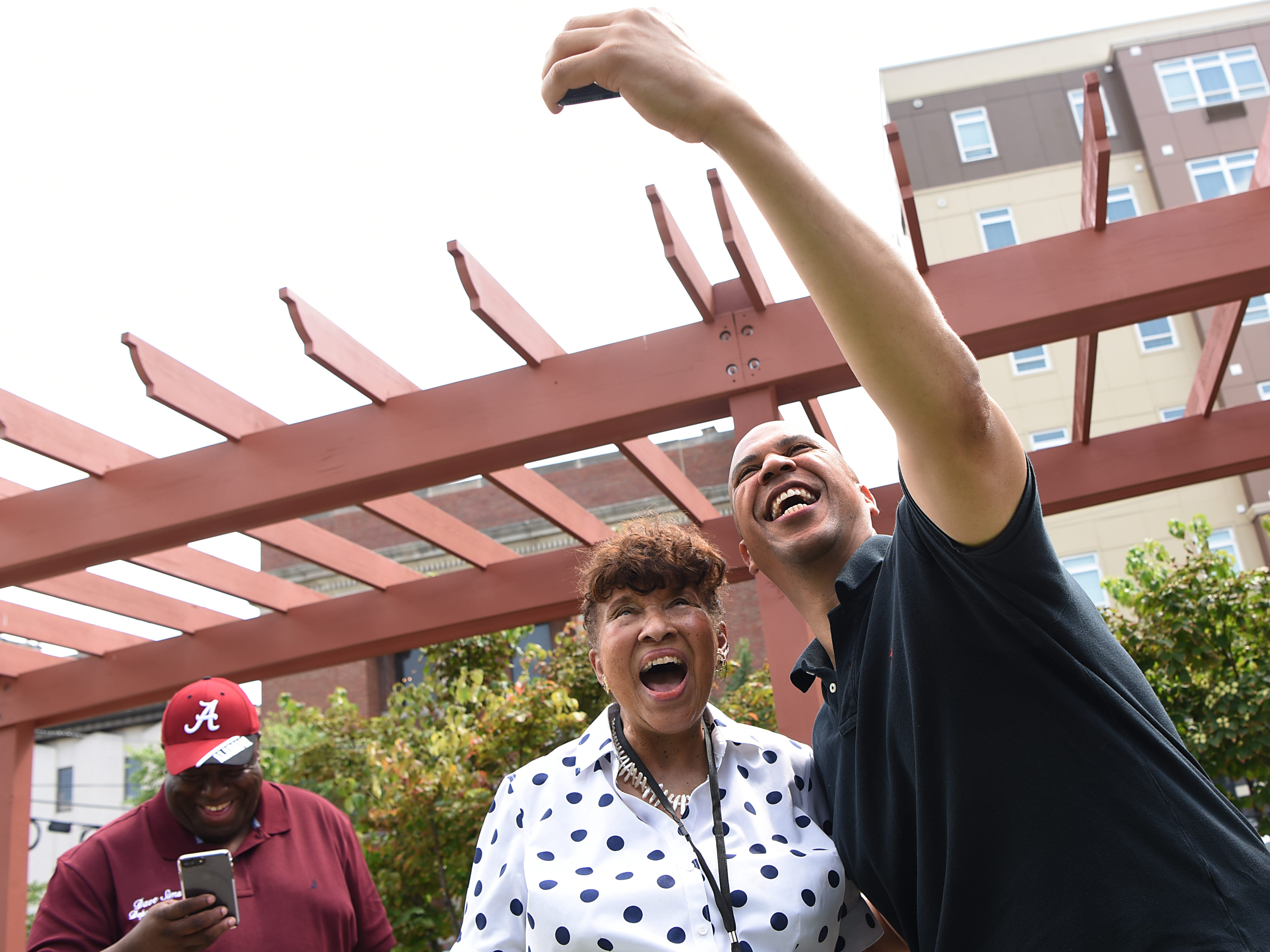 Lee Porter and Senatory Cory Booker take a selfie during the Fair Housing Council of Northern New Jersey picnic in Hackensack on Friday August 10, 2018.