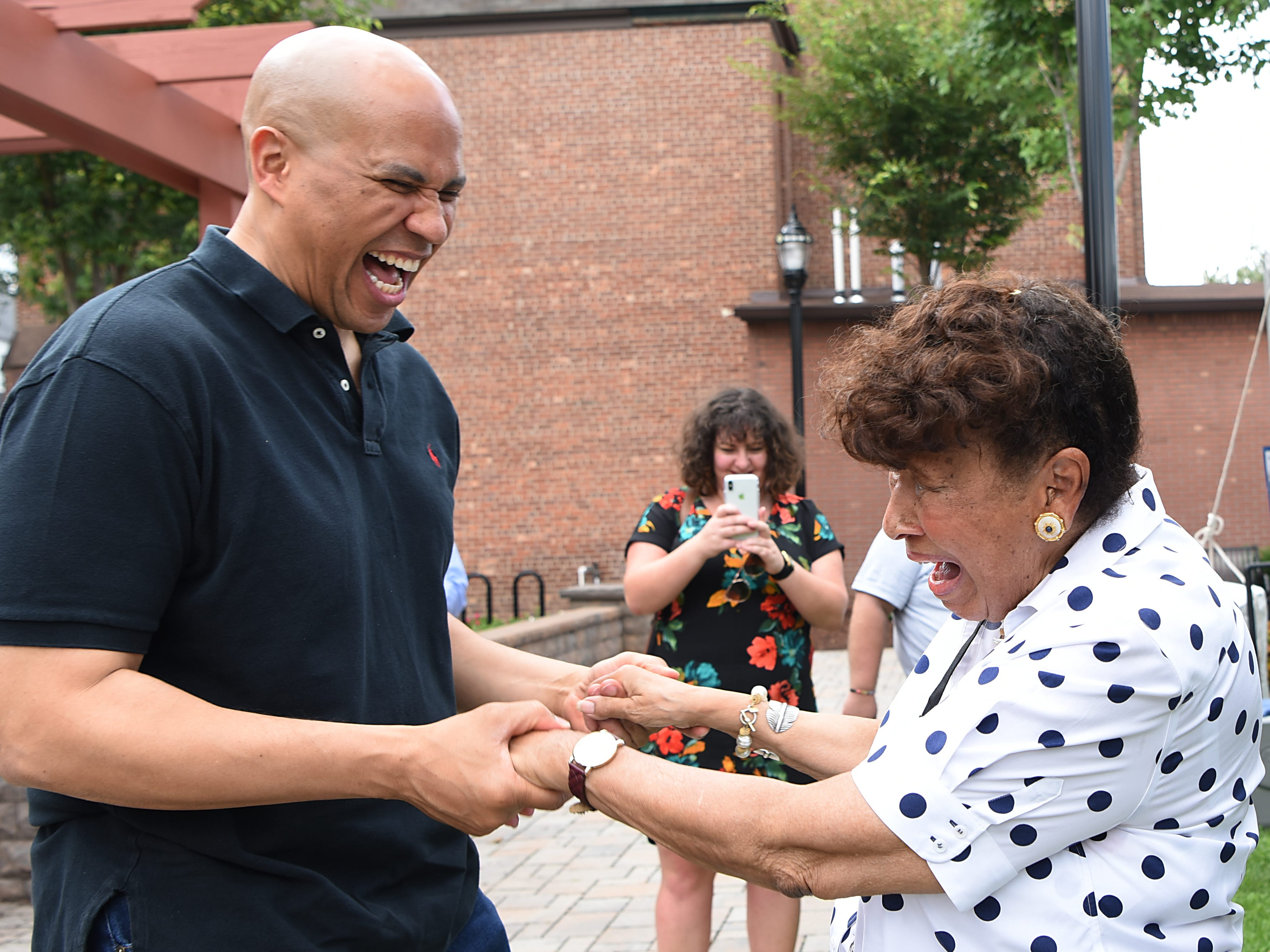 Senator Cory Booker greets Lee Porter during the Fair Housing Council of Northern New Jersey picnic in Hackensack on Friday August 10, 2018.
