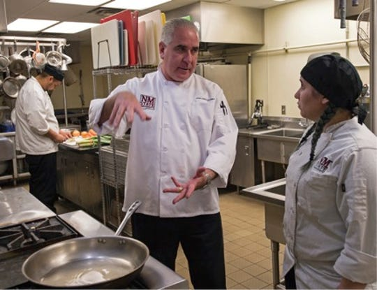 Chef John Hartley, professor in the School of HRTM, talks to Ashley Lucas about preparing a dish during class. Hartley and HRTM students worked alongside Chef Padilla at the Chef Artist Dinner.