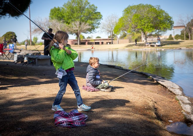 Children try their hand at fly casting during a Kids Fishing Clinic in 2016 at Alumni Pond at New Mexico State University.