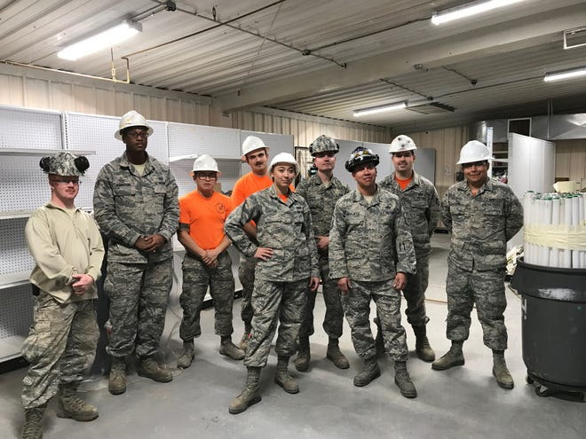 Airmen from the 49th Civil Engineer Squadron pose for a photo during the renovation of building 232.
