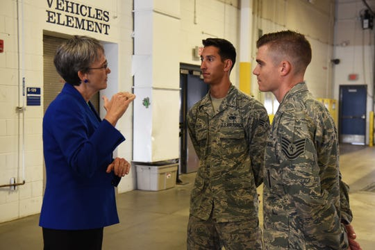 Secretary of the Air Force Heather Wilson speaks to Senior Airman Christopher Pilla, 90th Munitions Squadron nuclear weapons team member and Tech. Sgt. Evan McLelland, 90th Munitions Squadron nuclear weapons bay chief, during her tour Aug. 8, 2018, at F.E. Warren Air Force Base, Wyo. Pilla and McLelland were winners of the 90th Missile Wing's Innovation Fund and were discussing their idea of repaving the indoor track and banking the edges to help Airmen on base. Wilson visited the base to emphasize the importance of the wing's deterrence mission and to thank the Airmen for ensuring it is accomplished safely, securely and effectively every day.