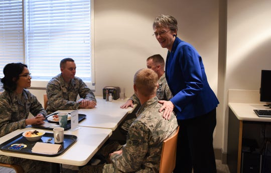 Secretary of the Air Force Heather Wilson greets Airmen during breakfast Aug. 8, 2018 at F.E. Warren Air Force Base, Wyo. Airmen of all ranks from various units across the base gathered for breakfast to provide Wilson with an overall perspective of their concerns and anticipations for the Air Force. Wilson visited F.E. Warren AFB to emphasize the importance of the 90th Missile Wing's deterrence mission and to thank the Airmen for ensuring the mission is accomplished safely, securely and effectively every day.