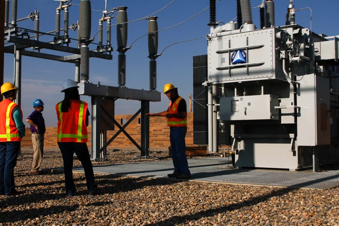 John Armenta, Engineering Manager for Farmington Electric Utility System, right, explains some unique features of the powerful new Cottonwood Substation Aug. 10 in Farmington. The high-capacity substation has state-of-the-art safety features to protect workers and avoid power outages.