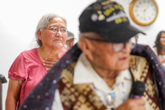 Arlene Johnson listens as her father, World War II veteran Steven Harrison Sr., gives a speech Friday during a ceremony hosted by the Quilts of Valor Foundation at the Farmington Indian Center.