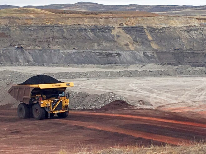 In this March 28, 2017, file photo, a dump truck hauls coal at Contura Energy's Eagle Butte Mine near Gillette, Wyoming.