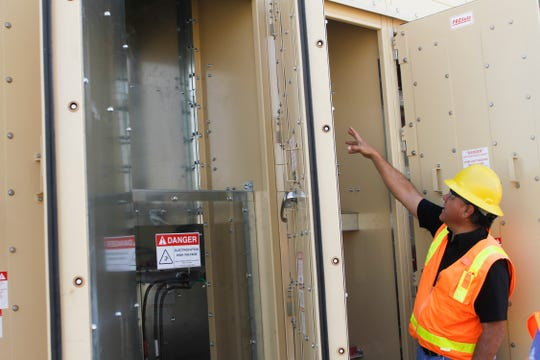 John Armenta, an engineering manager for Farmington Electric Utility System  leads a tour of the Cottonwood Substation, Friday, Aug. 10, 2018 in Farmington.