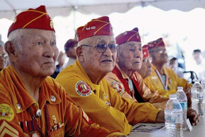 Participants in the Navajo Nation Code Talkers Day listen during a November 2014 ceremony in Window Rock, Ariz.