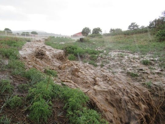 The Cherry Creek flow was heavy with silt from the mountains