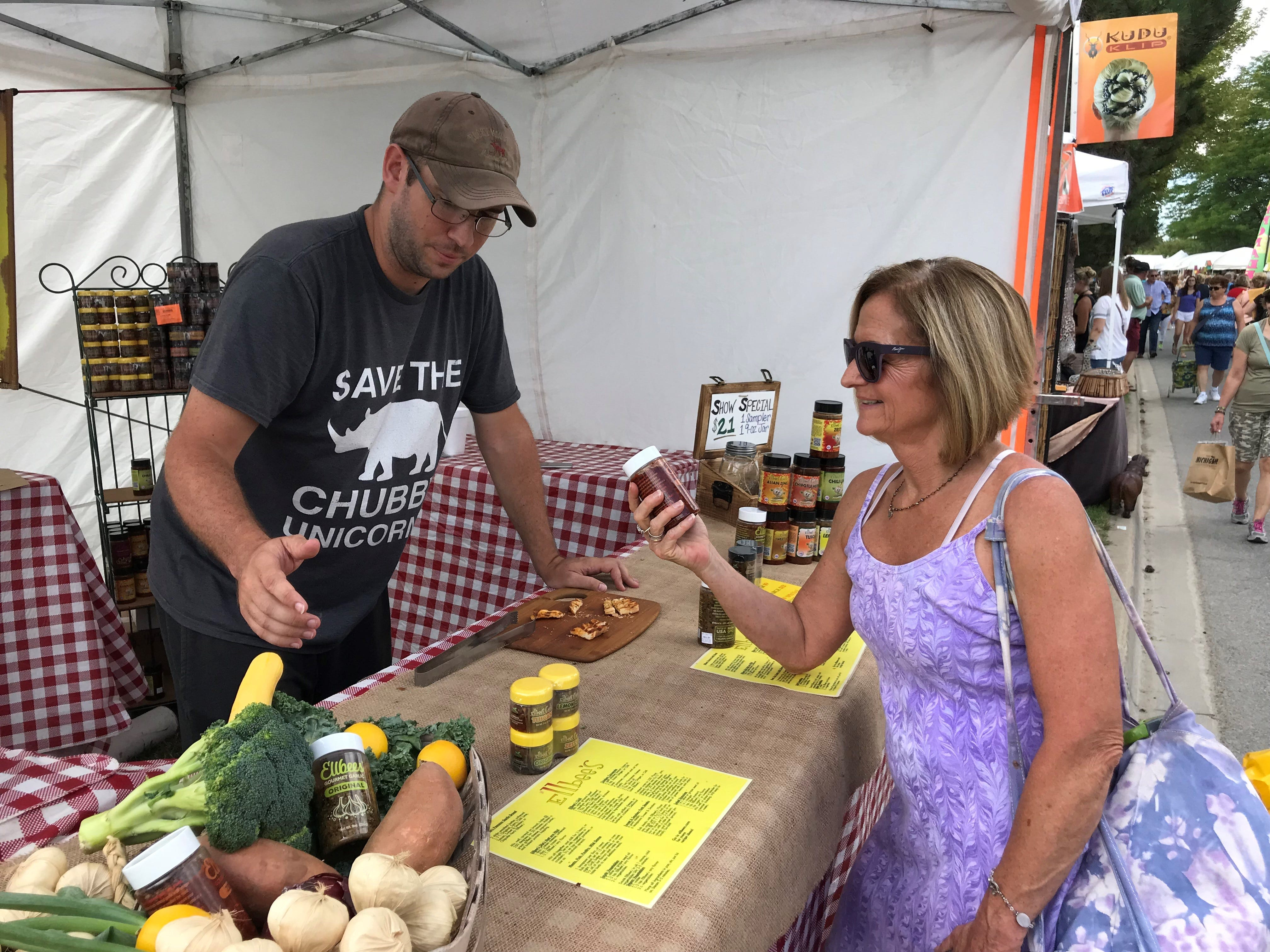 Susan Cline of Canton gets some advice from Adam Styer of Ellbee's Garlic.com.