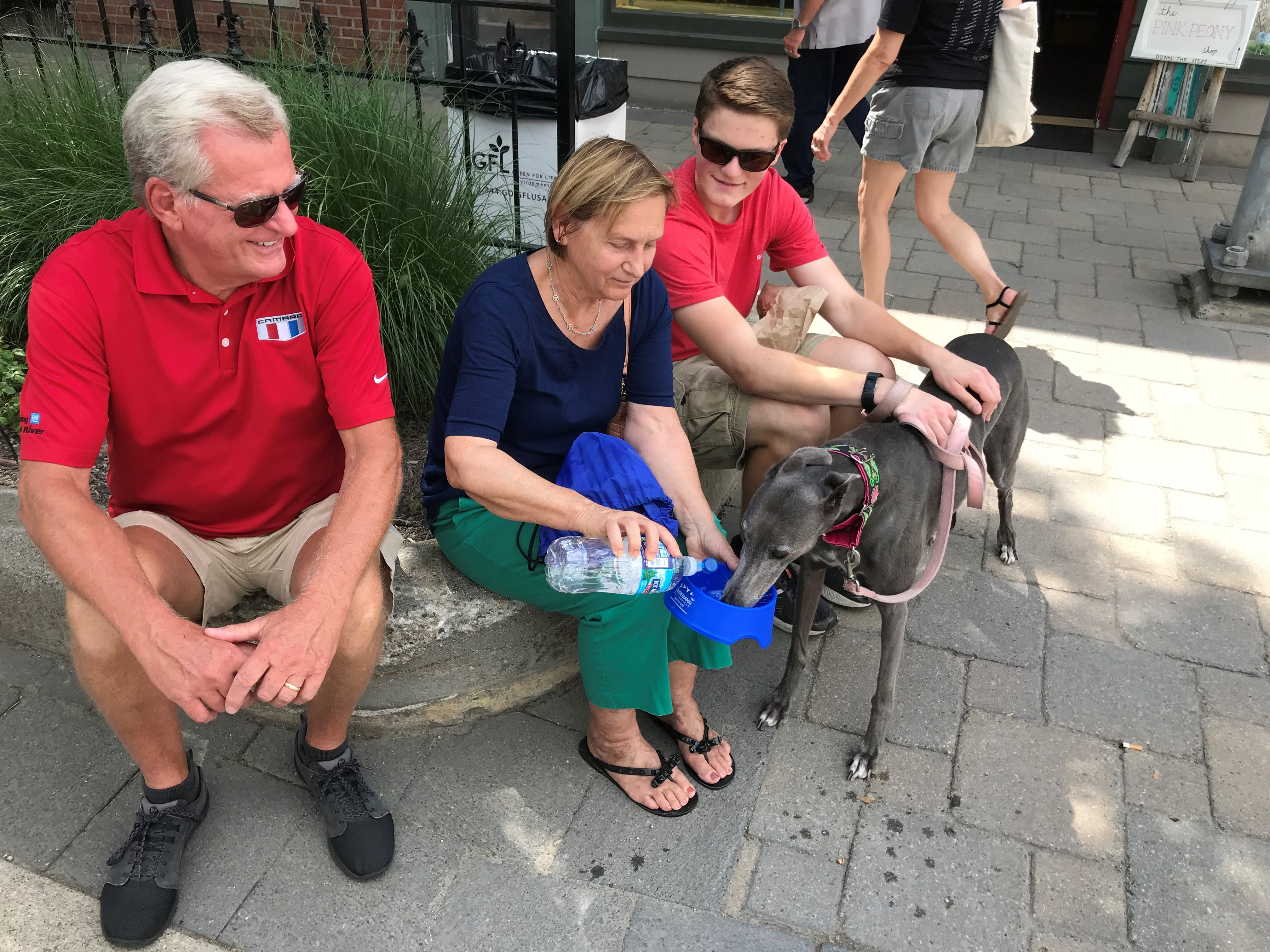 Wes (from left), Karol and John Spryshak make sure Gracie stays hydrated. Wes and Karol were up from Cincinnati to visit John's family. Gracie is visiting from Kentucky.