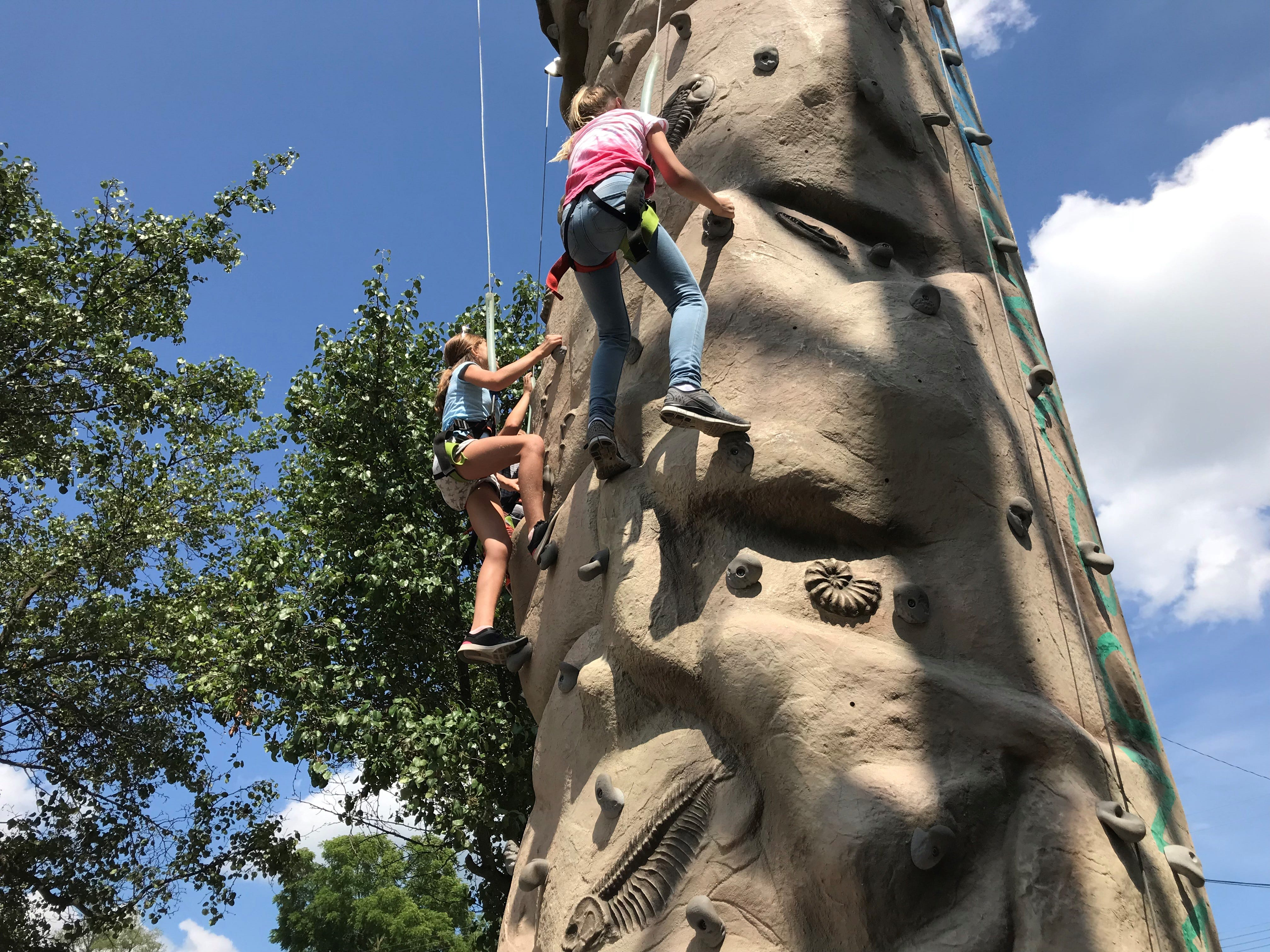 Abby and Olivia had little trouble with the climbing wall provided by Oakland County Parks.