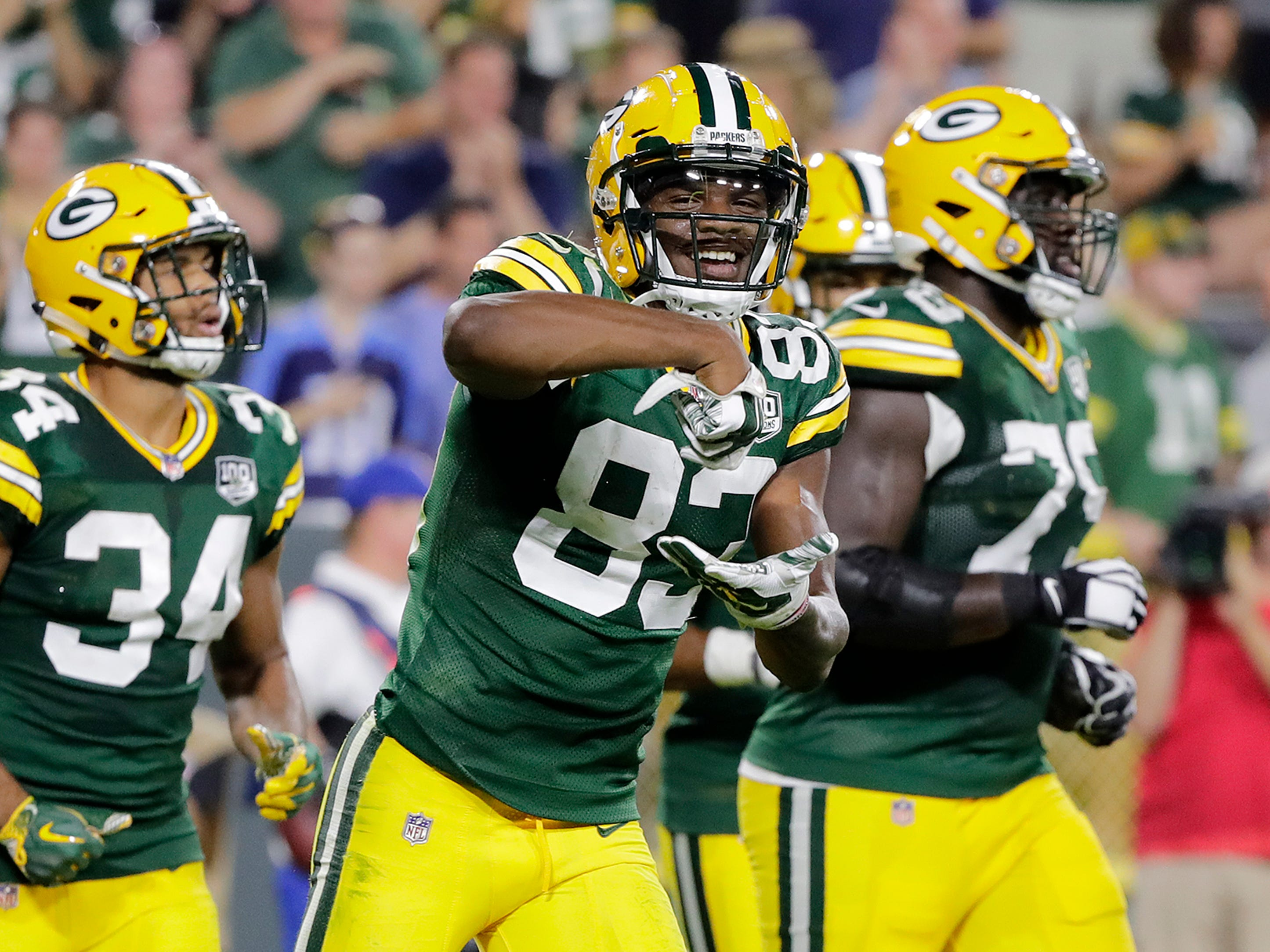 Green Bay Packers wide receiver Marquez Valdes-Scantling (83) celebrates after scoring a touchdown against the Tennessee Titans in the fourth quarter of an NFL preseason game at Lambeau Field on Thursday, August 9, 2018 in Green Bay, Wis.