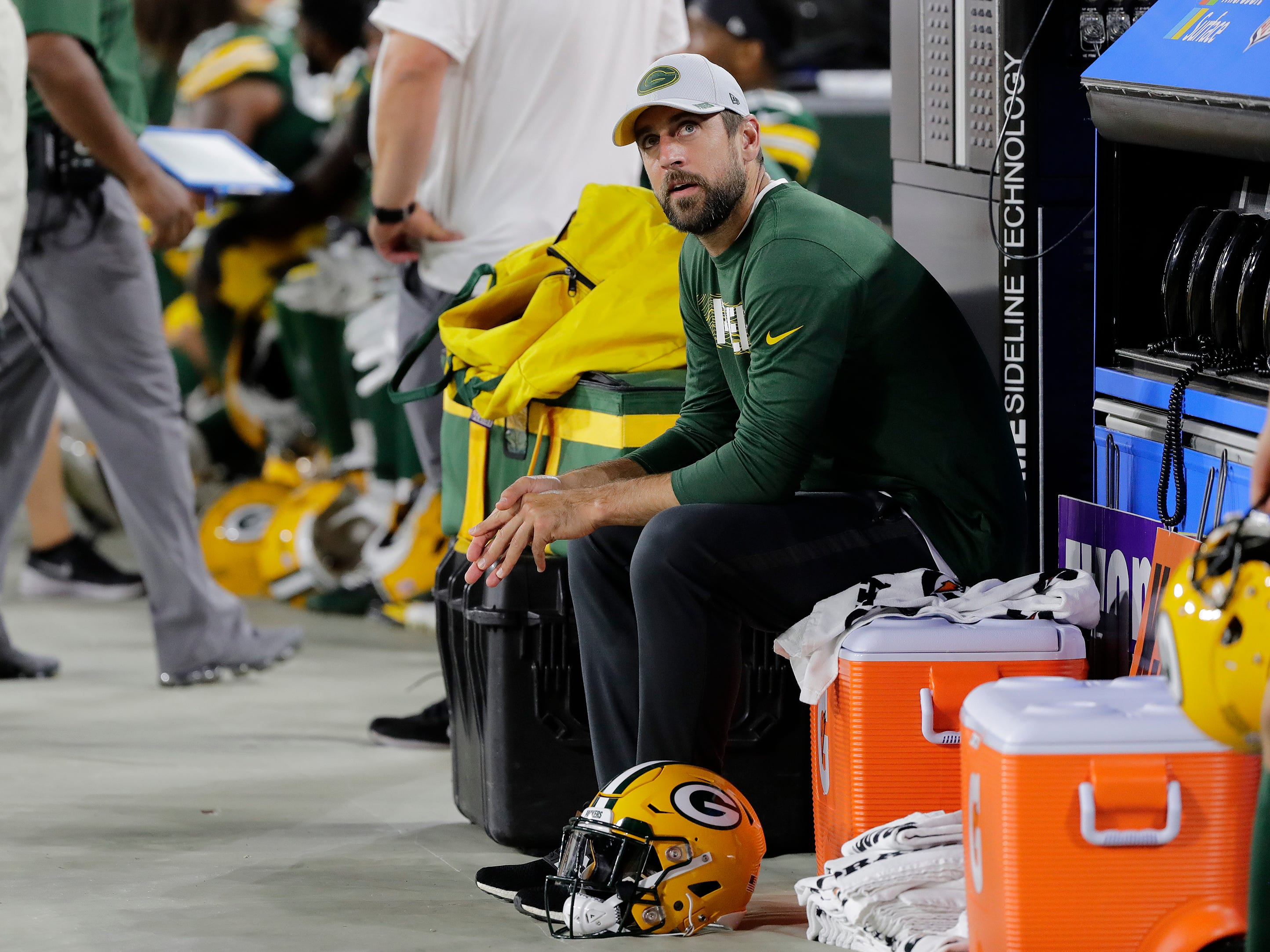 Green Bay Packers quarterback Aaron Rodgers (12) watches the final moments of an NFL preseason game against the Tennessee Titans from the sideline at Lambeau Field on Thursday, August 9, 2018 in Green Bay, Wis.
