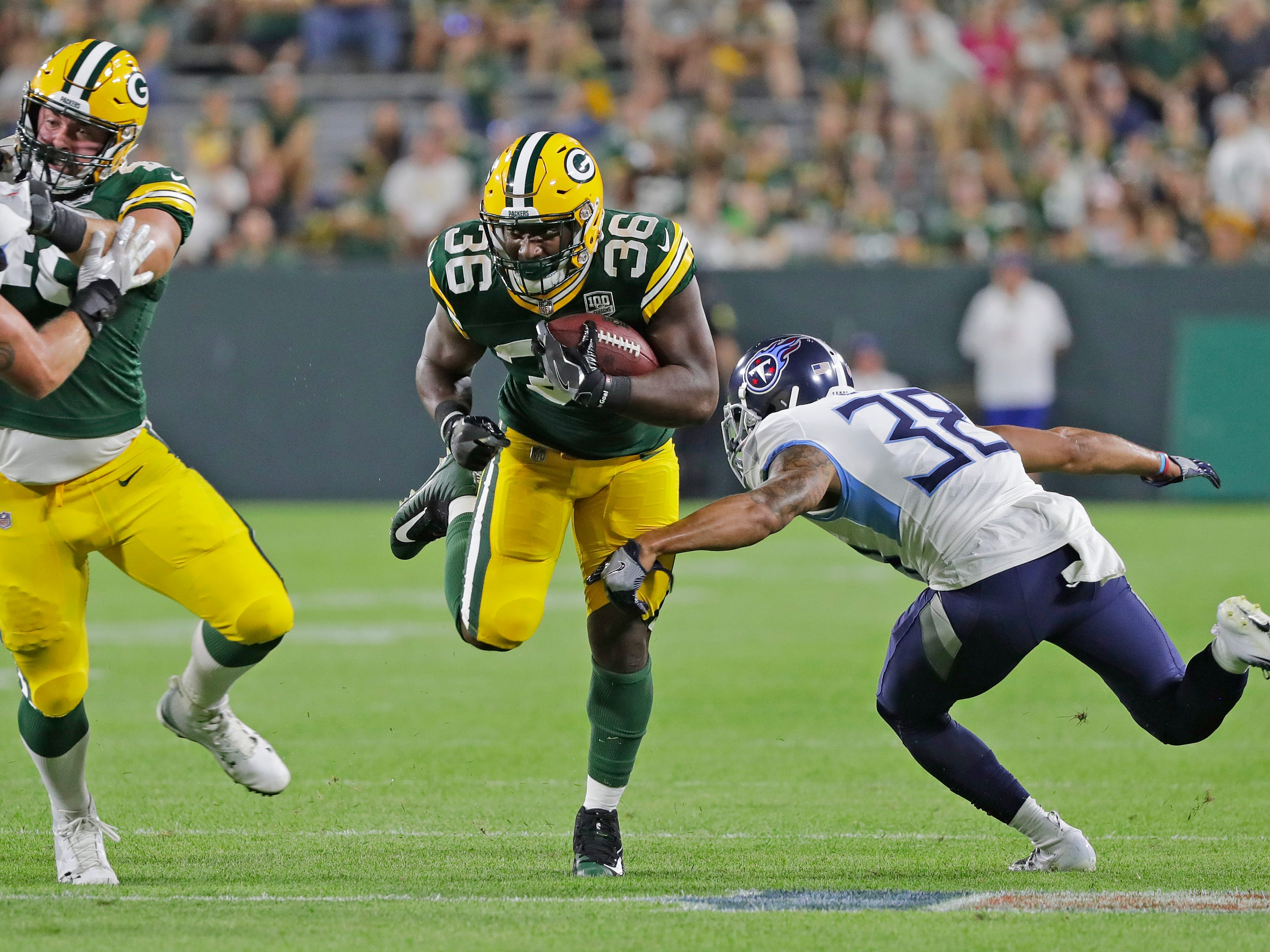 Green Bay Packers defensive back Akeem Judd (36) rushes against Tennessee Titans defensive back Joseph Este (38) in the fourth quarter of an NFL preseason game at Lambeau Field on Thursday, August 9, 2018 in Green Bay, Wis.