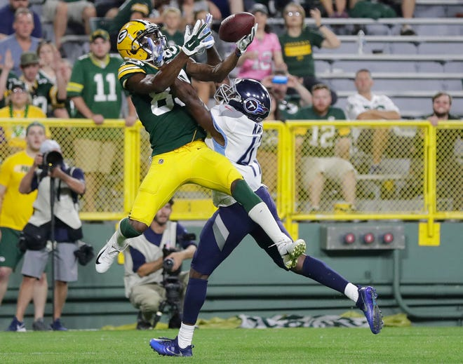 Green Bay Packers wide receiver Marquez Valdes-Scantling (83) catches a pass against the Tennessee Titans in the fourth quarter of an NFL preseason game at Lambeau Field on Thursday, August 9, 2018 in Green Bay, Wis.