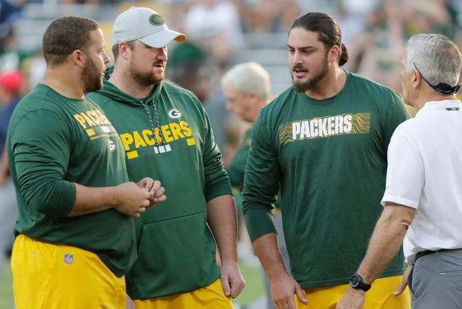 Green Bay Packers offensive tackle David Bakhtiari (69), offensive tackle Bryan Bulaga (75), and offensive guard Lane Taylor (65) talk before an NFL preseason game at Lambeau Field on Thursday, August 9, 2018 in Green Bay, Wis. Adam Wesley/USA TODAY NETWORK-Wisconsin