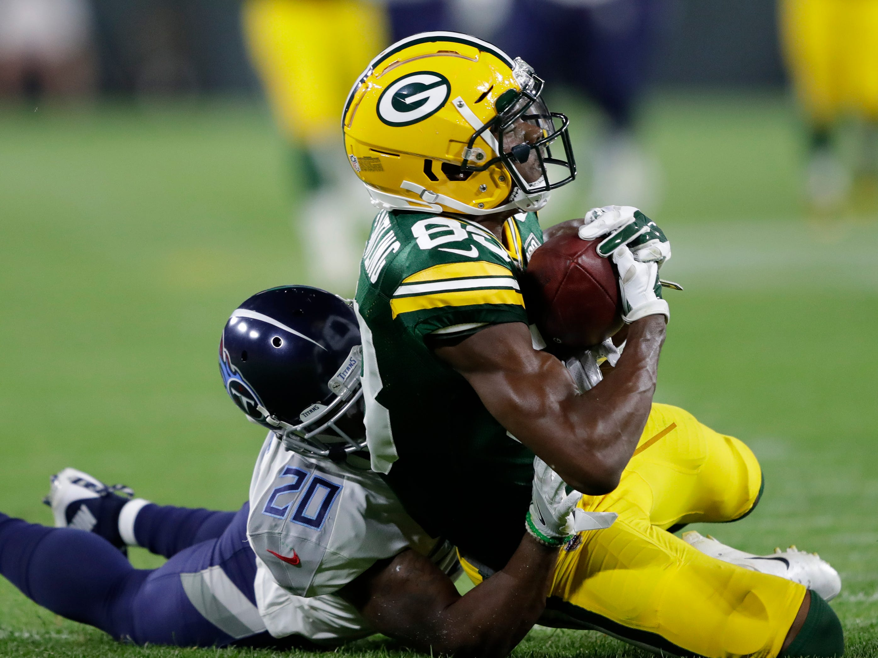 Green Bay Packers wide receiver Marquez Valdes-Scantling (83) pulls down a long reception against Tennessee Titans defensive back Demontre Hurst in the third quarter during their football game Thursday, August 9, 2018, at Lambeau Field in Green Bay, Wis.