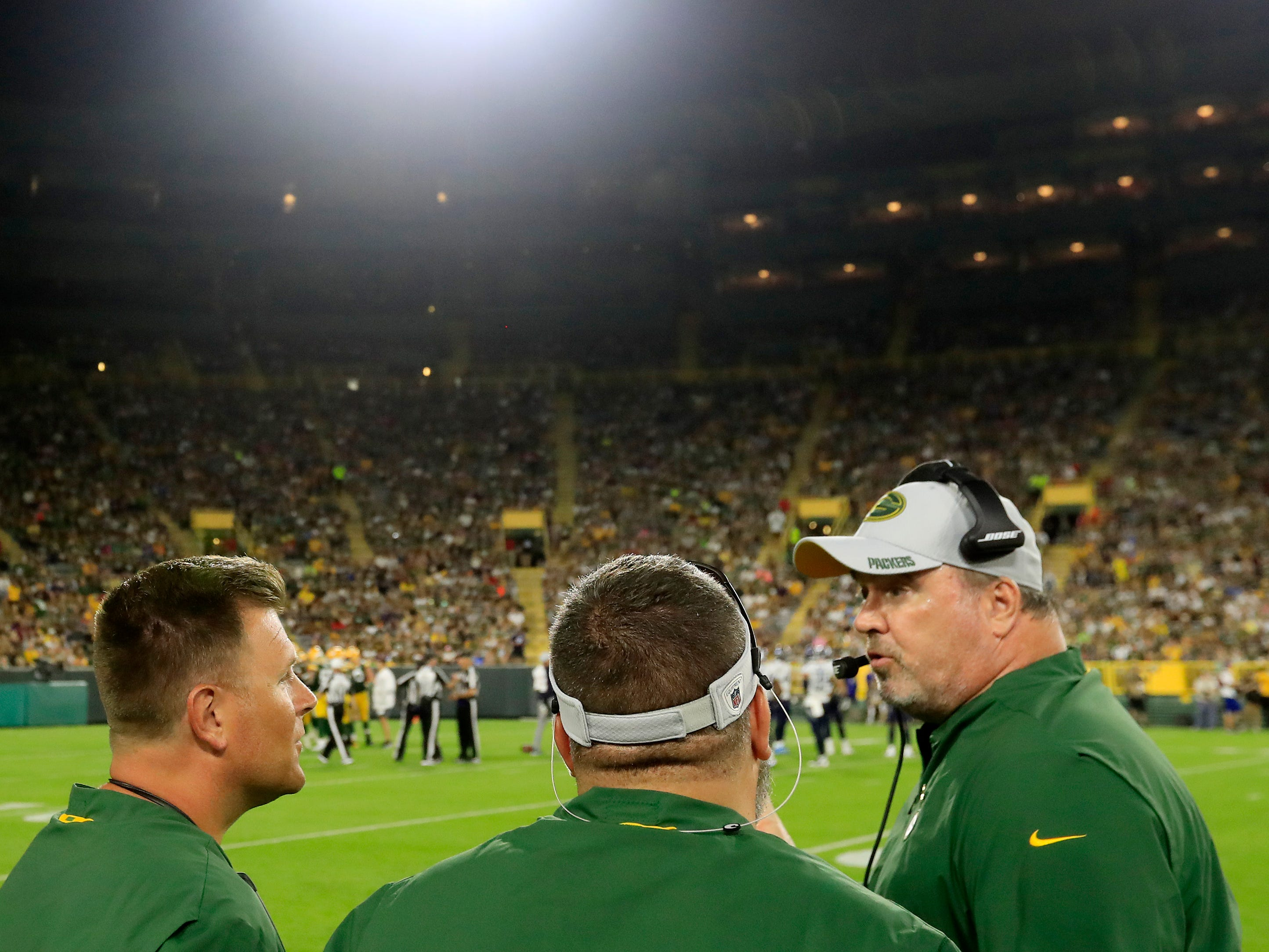 Green Bay Packers head coach Mike McCarthy talks with GM Brian Gutekunst during an NFL preseason game at Lambeau Field on Thursday, August 9, 2018 in Green Bay, Wis.