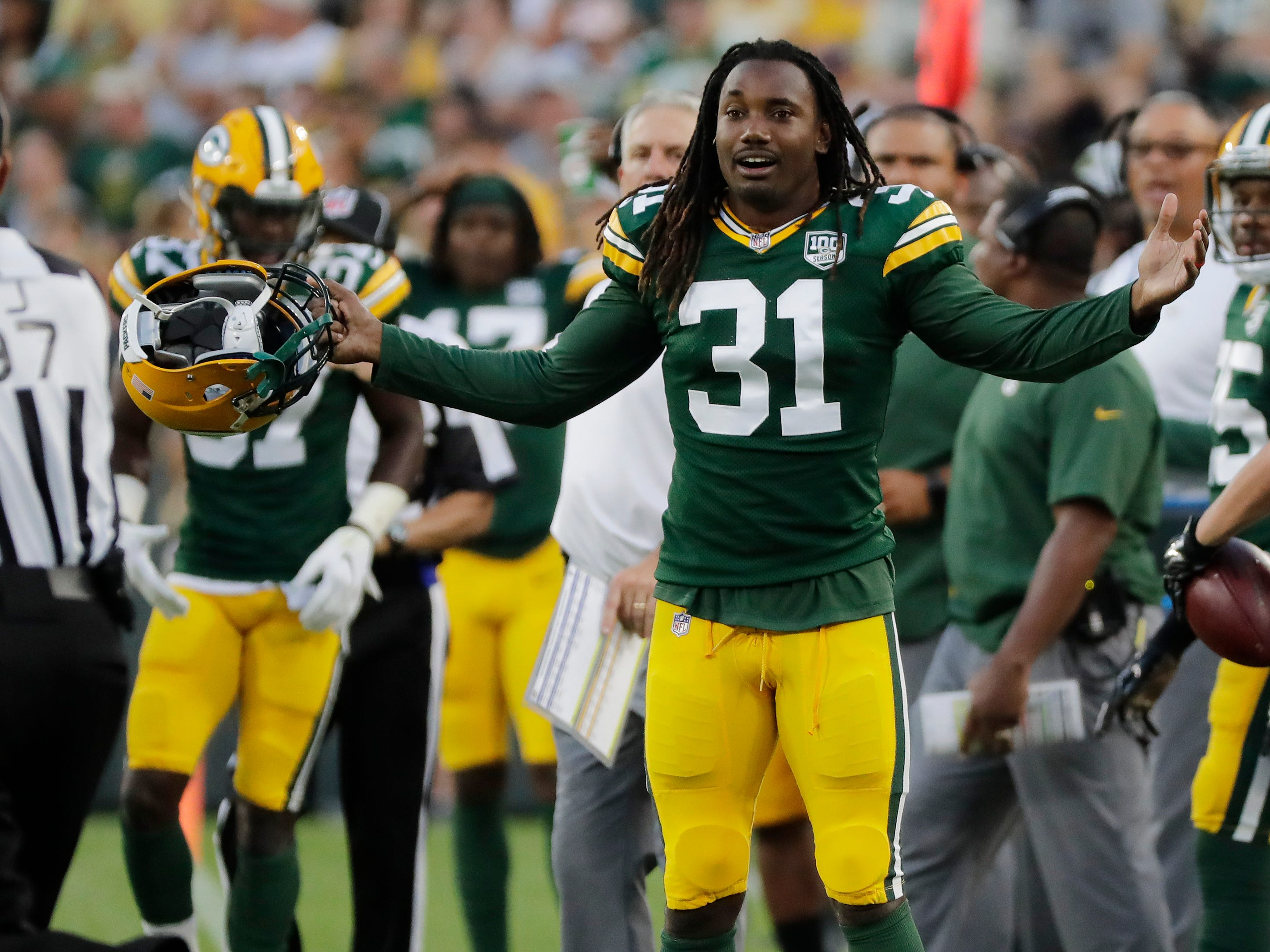 Green Bay Packers defensive back Davon House (31) reacts as the Packers are called for a penalty in the first half against the Tennessee Titans in an NFL preseason game at Lambeau Field on Thursday, August 9, 2018 in Green Bay, Wis.