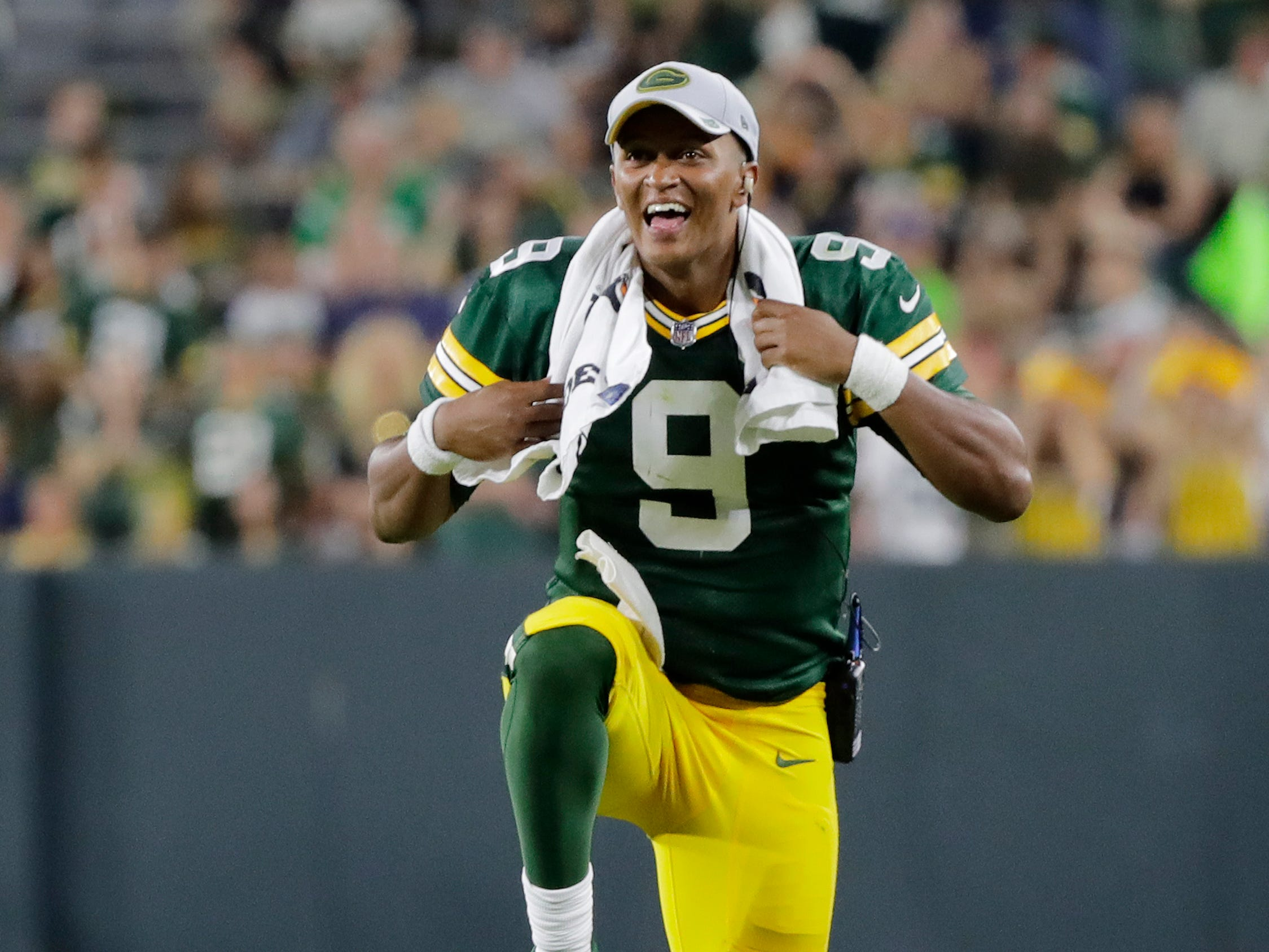 Green Bay Packers quarterback DeShone Kizer (9) celebrates after a Packers touchdown in an NFL preseason game at Lambeau Field on Thursday, August 9, 2018 in Green Bay, Wis.