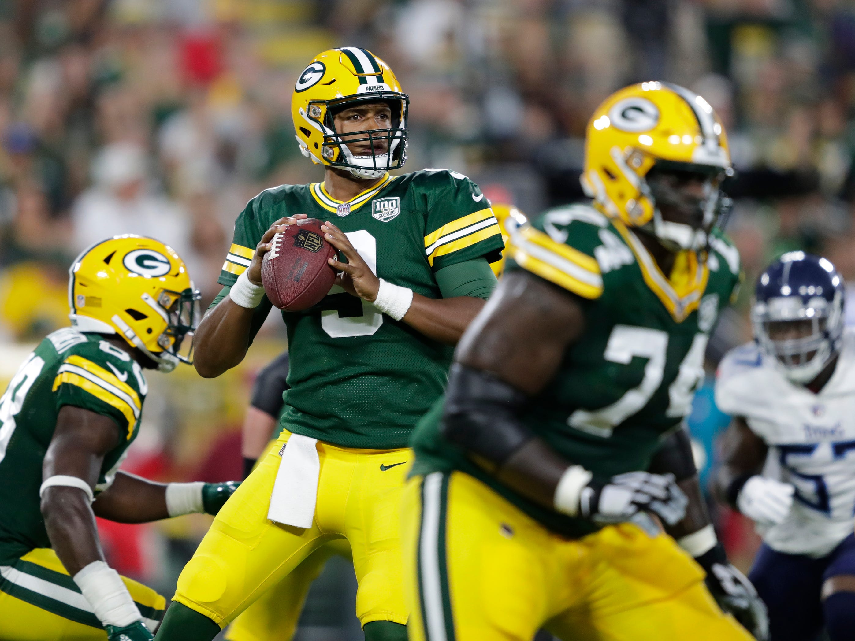 Green Bay Packers quarterback DeShone Kizer (9) looks to pass against the Tennessee Titans during their football game Thursday, August 9, 2018, at Lambeau Field in Green Bay, Wis.