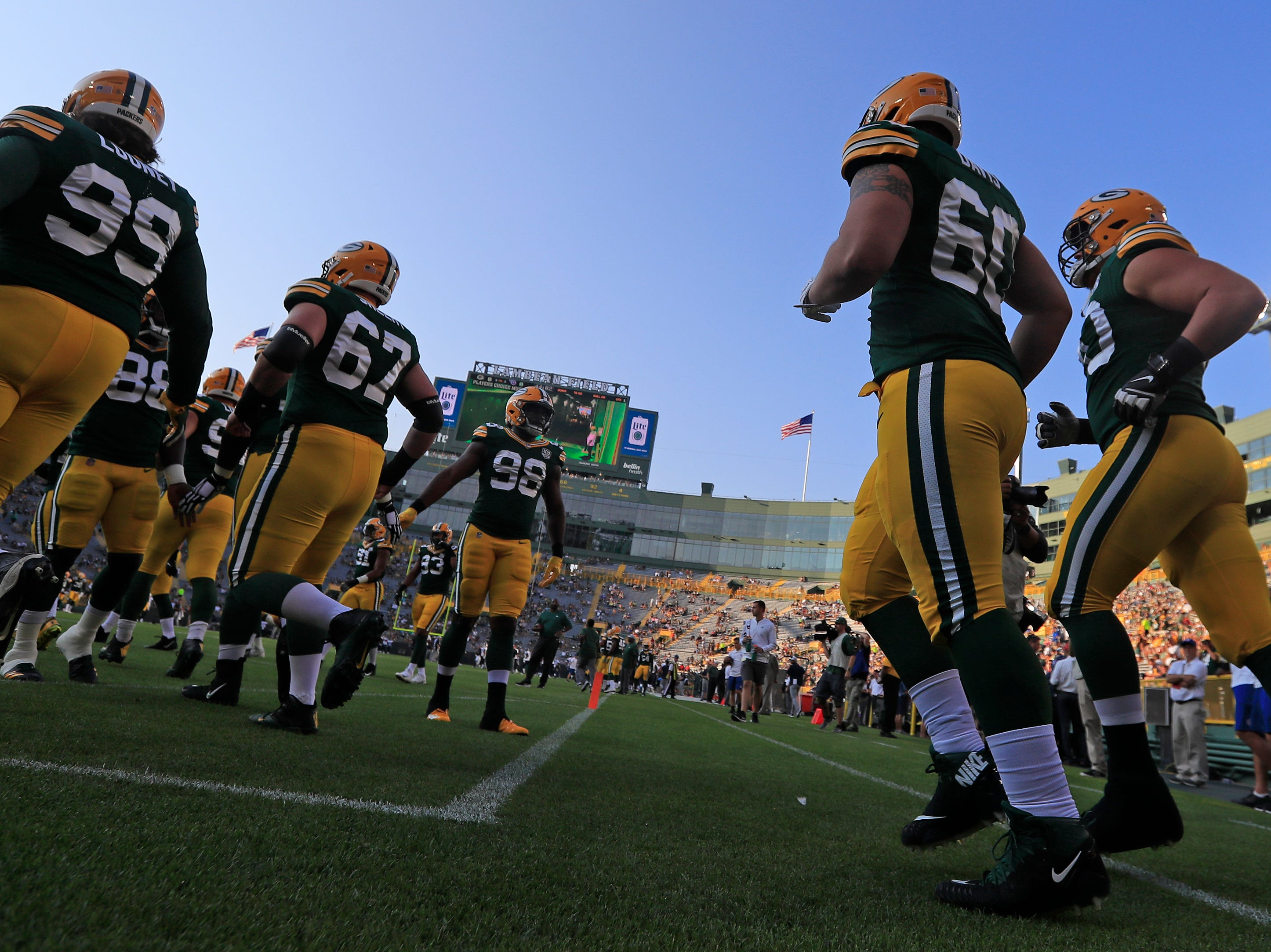 The Green Bay Packers take the field for a NFL preseason game at Lambeau Field on Thursday, August 9, 2018 in Green Bay, Wis.
