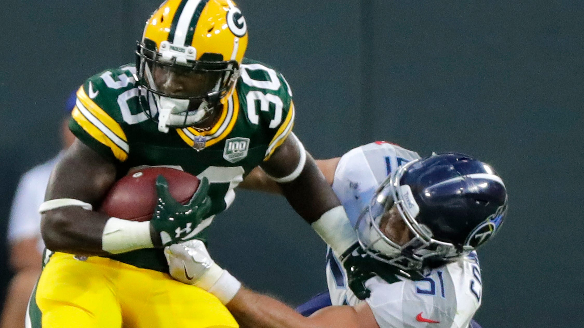 Green Bay Packers running back Jamaal Williams (30) rushes against the Tennessee Titans in the first half of an NFL preseason game at Lambeau Field on Thursday, August 9, 2018 in Green Bay, Wis.