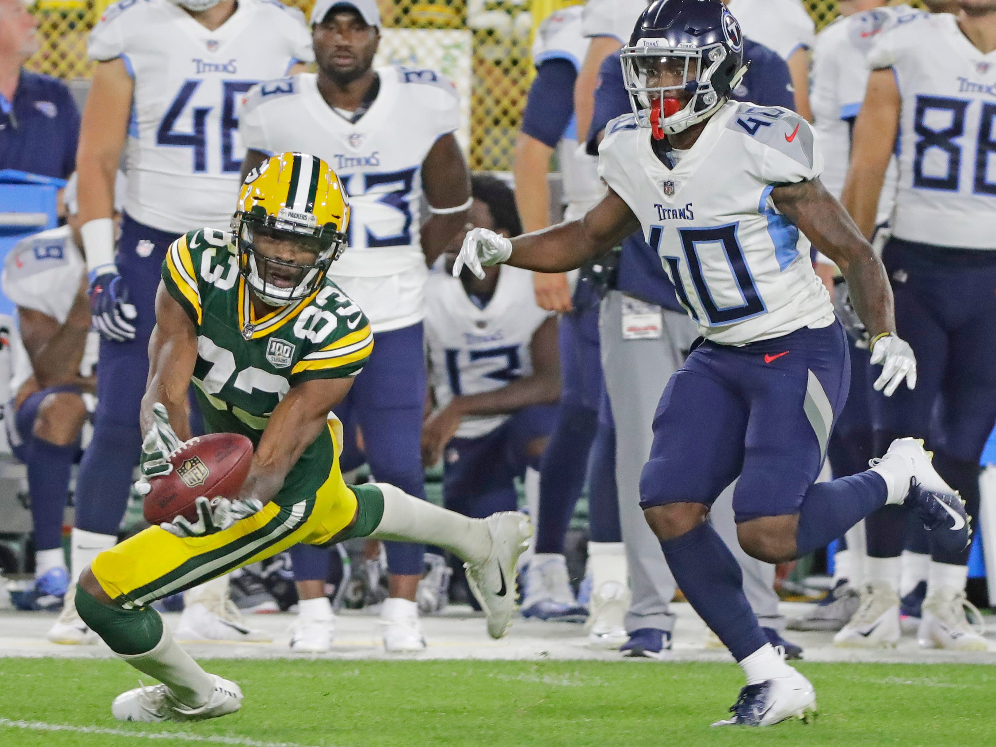 Green Bay Packers wide receiver Marquez Valdes-Scantling (83) attempts to catch a pass against Tennessee Titans cornerback Rico Gafford (40) in the fourth quarter of an NFL preseason game at Lambeau Field on Thursday, August 9, 2018 in Green Bay, Wis.
