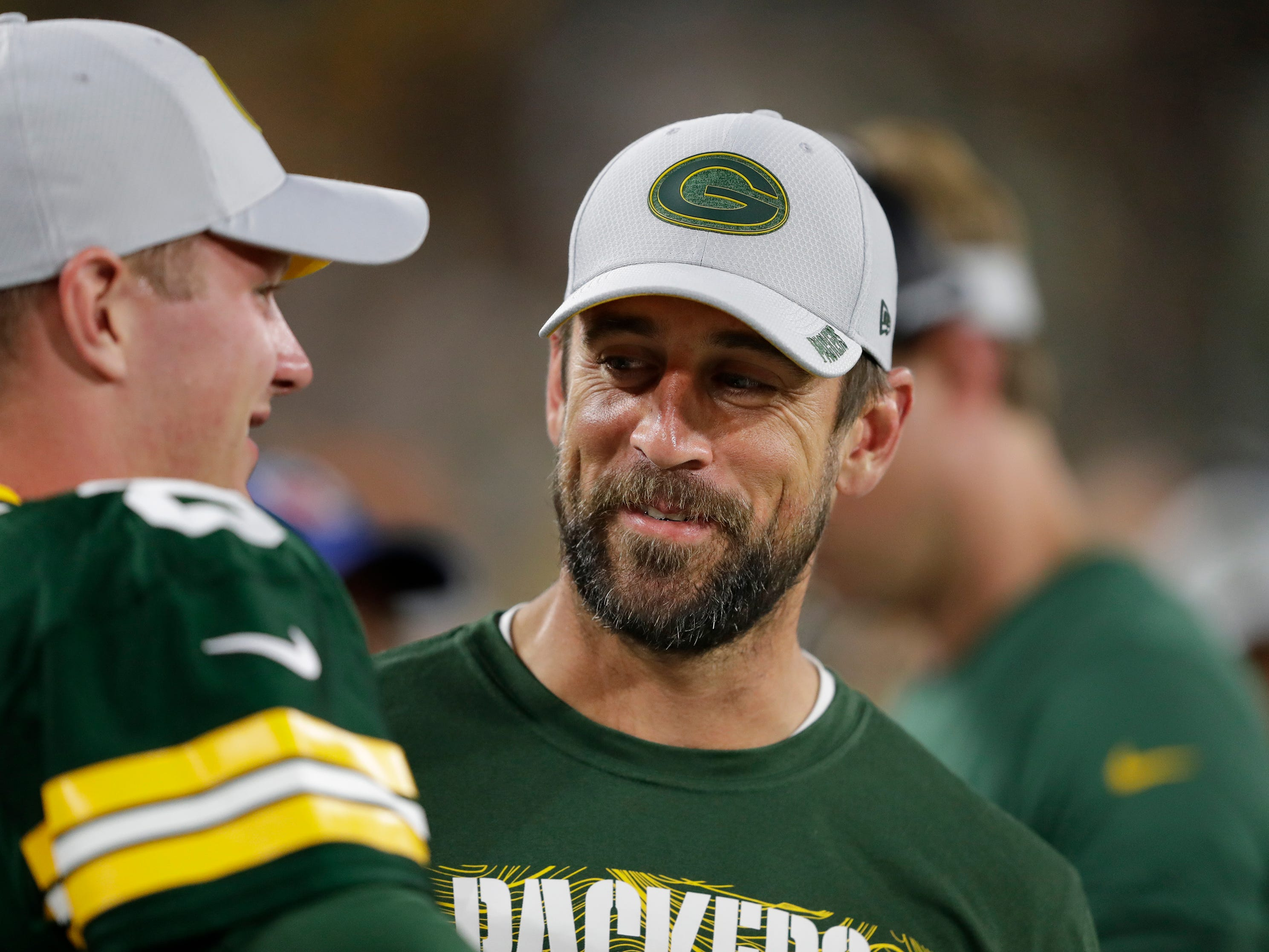 Green Bay Packers quarterback Aaron Rodgers (12) and Tim Boyle (8) share a laugh on the sidelines against the Tennessee Titans during their football game Thursday, August 9, 2018, at Lambeau Field in Green Bay, Wis.