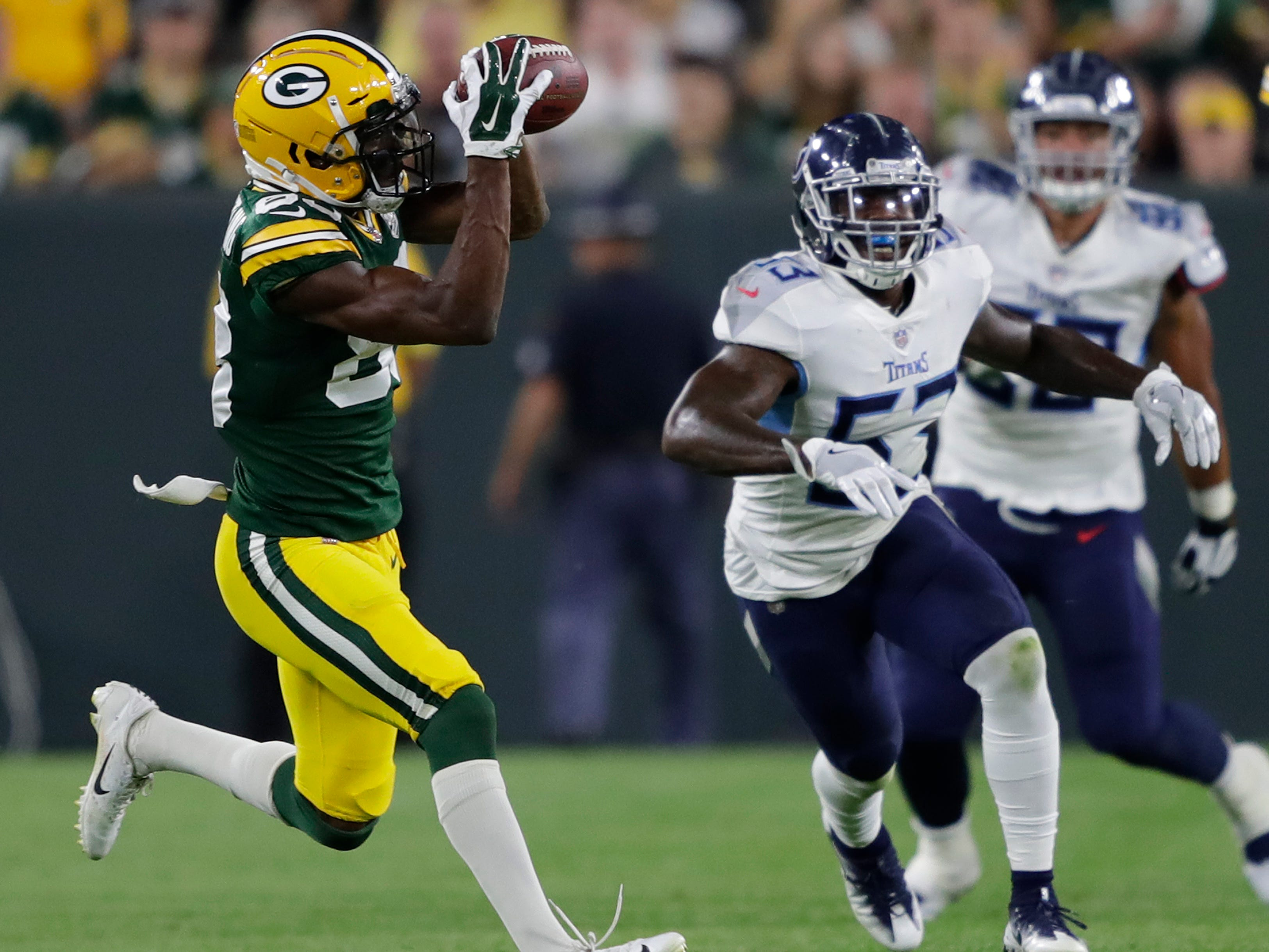 Green Bay Packers wide receiver Marquez Valdes-Scantling (83) pulls down a reception against the Tennessee Titans during their football game Thursday, August 9, 2018, at Lambeau Field in Green Bay, Wis.