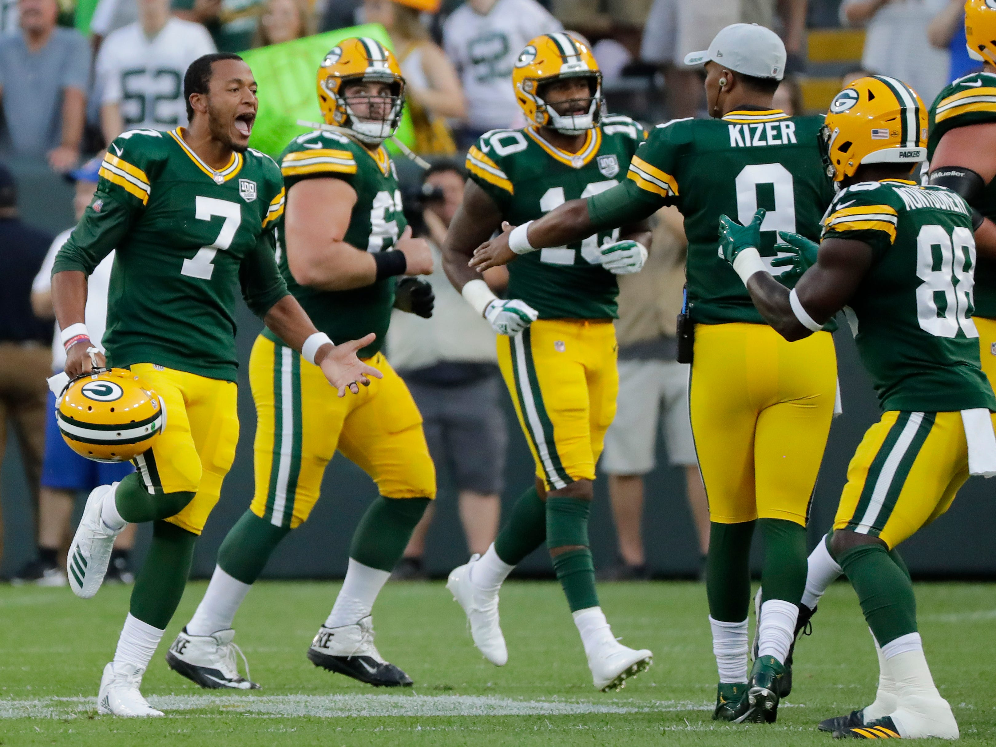 Green Bay Packers quarterback Brett Hundley (7) celebrates after throwing a touchdown against the Tennessee Titans in the first half of a NFL preseason game at Lambeau Field on Thursday, August 9, 2018 in Green Bay, Wis.
