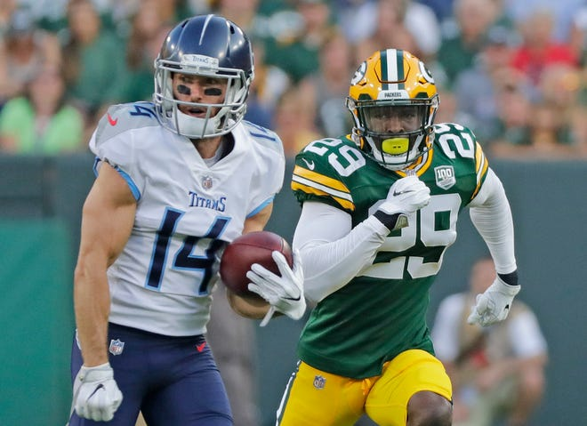 Green Bay Packers defensive back Kentrell Brice (29) chases Tennessee Titans wide receiver Nick Williams (14) in an NFL preseason game at Lambeau Field on Thursday, August 9, 2018 in Green Bay, Wis. 